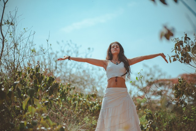 woman feeling attuned with herself and the universe